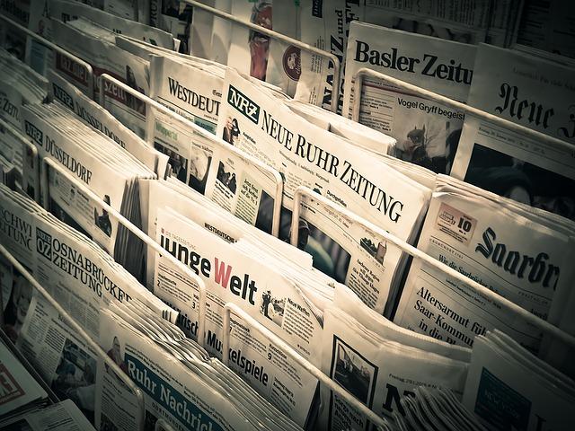 noviny ve stojanu.jpg